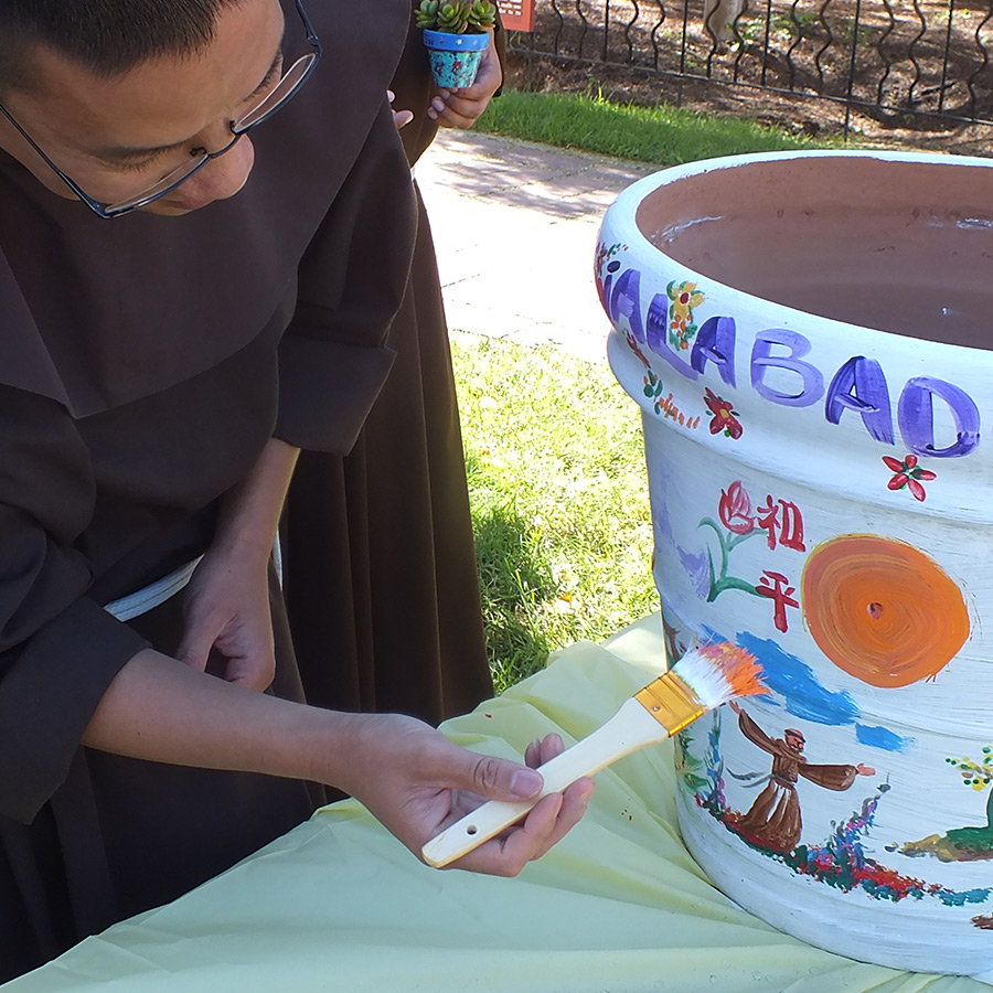 student-friar-painting-pot-web
